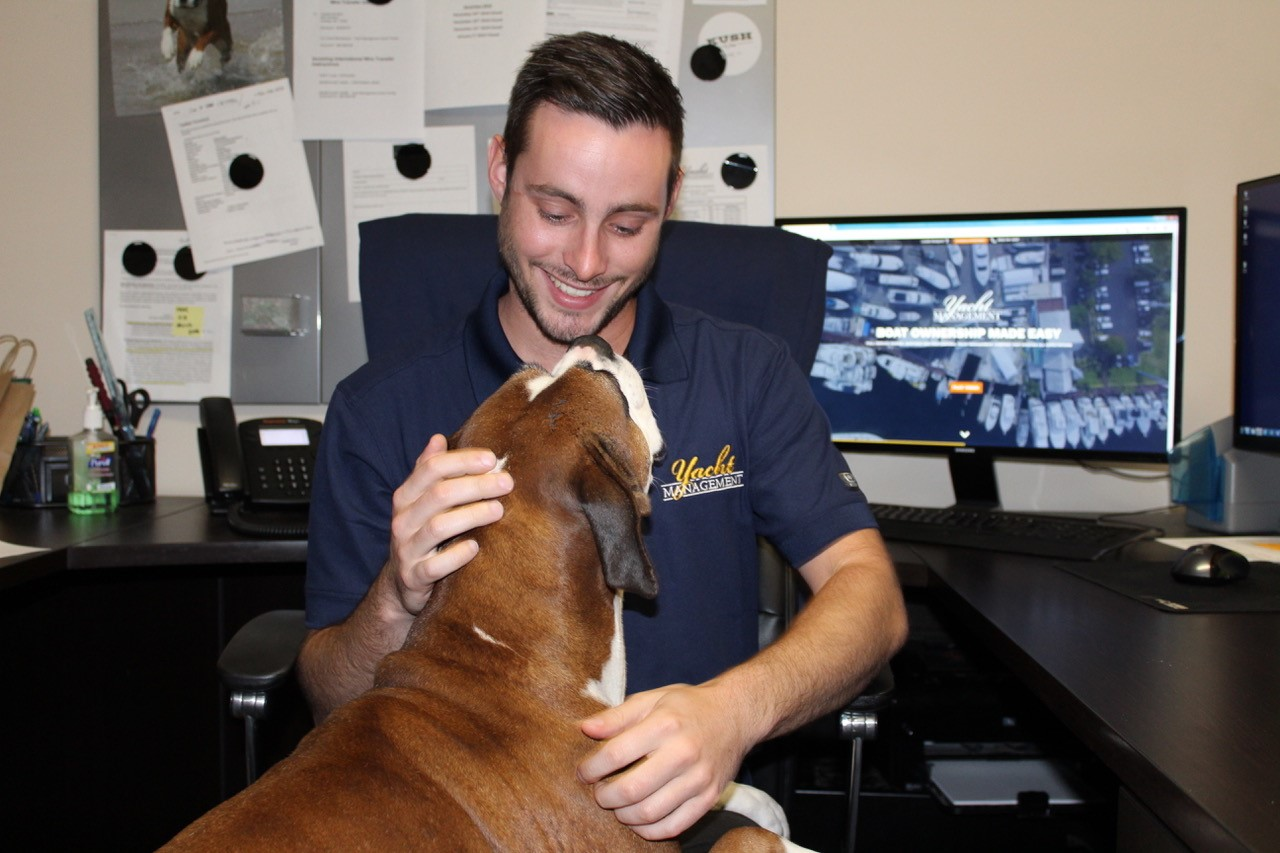 Joe Donofrio and his dog at the Yacht Management offices